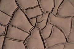 Droog gebarsten grond Stock Foto