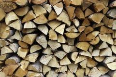 Droog gehakt brandhout registreert backround textuur royalty-vrije stock afbeeldingen
