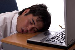 Drool. Young asian businessman taking a nap on the job Royalty Free Stock Photo