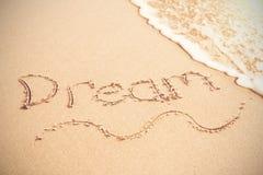 Droom die op zand wordt geschreven Stock Foto
