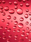Drop. Red background and water drop. Waterdrop Royalty Free Stock Photos