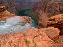 Drop. Rain runoff flowing off the edge of the Colorado River gorge near Page Arizona Stock Images