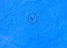 Drop. One single drop in water making concentric circles royalty free stock photo