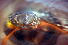 Drop. The round transparent drop of water falls downwards Stock Images