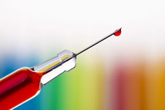 Drop of blood over rainbow Royalty Free Stock Photo