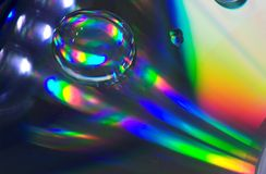 Drop on CD-disk. Play of the light on CD-disk Royalty Free Stock Image