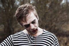Drop dead zombie bleeding Royalty Free Stock Photography