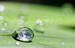 Drop and earth Royalty Free Stock Photo
