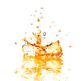 Drop falling into orange water with splash isolated on white Stock Photos