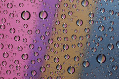 Drop on the glass three. Water drops on the glass Royalty Free Stock Photography