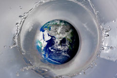 Drop the globe. A picture of the globe being dropped in water Stock Photos