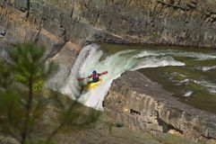 The Drop. A Kayaker plumets off the Falls in his kayak Stock Image