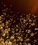 Drop of liquid shining amber Royalty Free Stock Photo