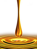Drop of oil. Falling drop of oil on a white background Royalty Free Stock Image