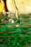 Drop of orange juice. Royalty Free Stock Images