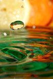 Drop of orange juice. Royalty Free Stock Photo