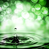 Drop over bokeh lights Royalty Free Stock Images