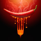 Drop Pepper. Very hot pepper stuck on the fork Royalty Free Stock Photos