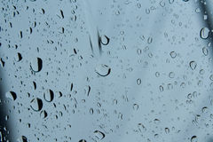 Drop. Rain drops on clear glass shades Stock Image