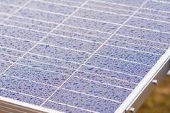Drop of rain on solar cells Stock Photos