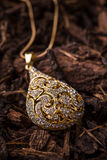 Drop shaped pendant. With small rhinestones stock images