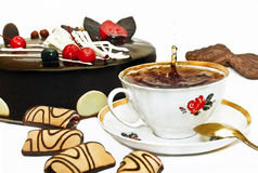 A drop of tea. Pastry cake and biscuits with tea royalty free stock photo