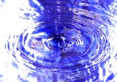Drop of water. Liquid, drop, blue, splashing, water, macro Royalty Free Stock Images