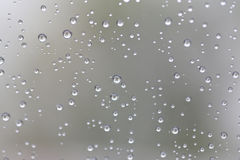 Drop of water for the background on glass car window to abstract Stock Images
