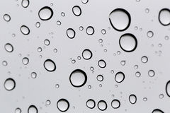 Drop of water for the background on glass car window to abstract Royalty Free Stock Photography