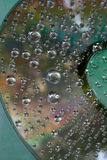 Drop of water  on CD and DVD. An image of a nice water drop on CD and DVD Royalty Free Stock Image