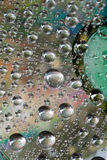 Drop of water  on CD and DVD. An image of a nice waterdrop on CD and DVD Stock Images