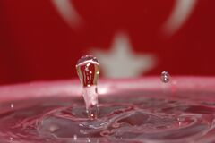 Drop of Water Falling Into a Larger Body of Water Royalty Free Stock Photography