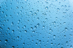 Drop water on glass. With blue background Stock Image