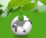 Drop of water with globe. Closeup of a leaf with waterdrop and globe Royalty Free Stock Photography