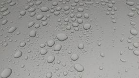 Drop. Of water on gray surface Royalty Free Stock Image