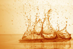 Drop of water in puddle in gold royalty free stock photography