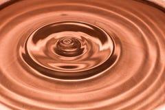 Drop of water, water splash in Brown color. Water splash in brown color Royalty Free Stock Photo