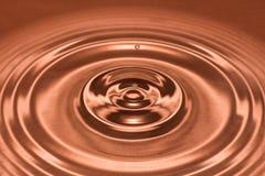 Drop of water, water splash in Brown color. Water splash in brown color Stock Images