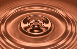 Drop of water, water splash in brown color. stock photography