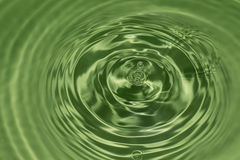 Drop of water, water splash in Green color. Water splash in brown color Royalty Free Stock Photography