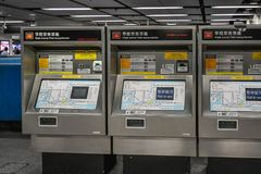Drop Your Money for an MTR ride. Electronic ways to purchase tickets for the MTR in Hong Kong.  Simply choose your destination and the machine will give you the Stock Photo