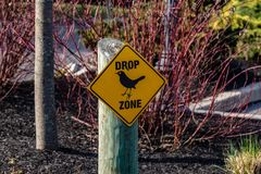 Drop Zone Sign. A drop zone sign warning of bird droppings in the immediate area stock image