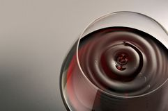 Droplet. Of red wine falling in a glass Royalty Free Stock Photography
