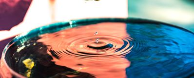 Droplet blue red water bucket Stock Photo