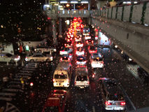 Droplet on glass with blur traffic jam at night. Royalty Free Stock Photography