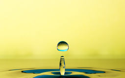 Droplet of water from a splash Stock Images