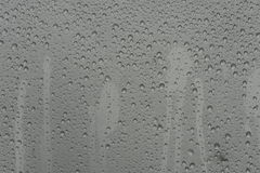 Droplets. Water droplets on an aluminium surface Royalty Free Stock Images