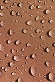 Droplets on brown fabric Stock Images