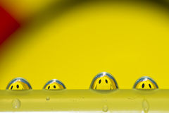 Droplets team. Funny water droplets with smiley reflection Stock Image
