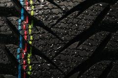 Droppar för bilgummihjul och vatten Arkivfoton
